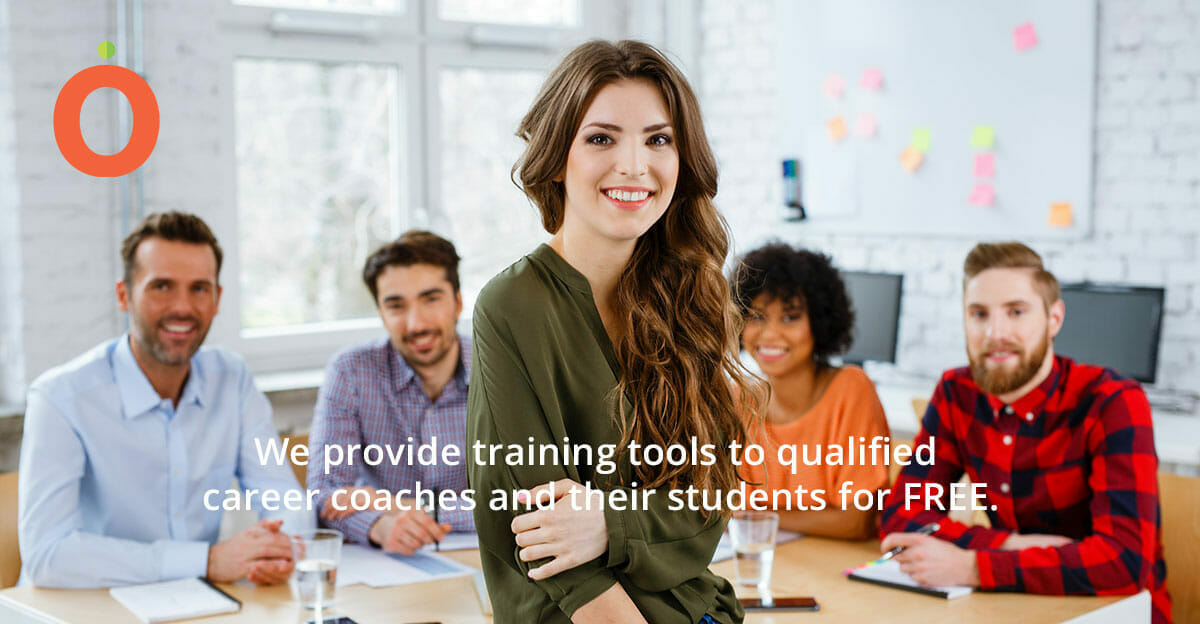 Career coach with students at desk in background.